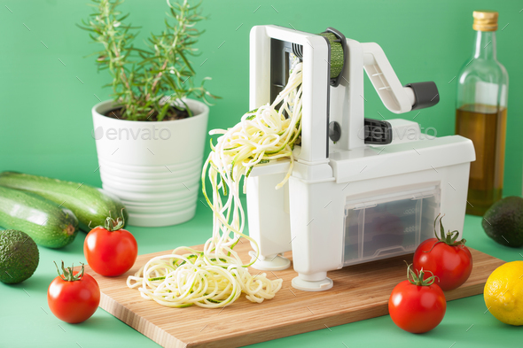 spiralizing courgette raw vegetable with spiralizer - Stock Photo - Images
