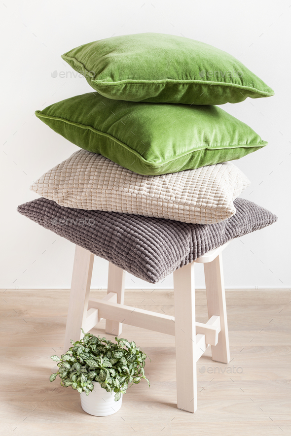 gray and green cushions, houseplant. cozy home - Stock Photo - Images