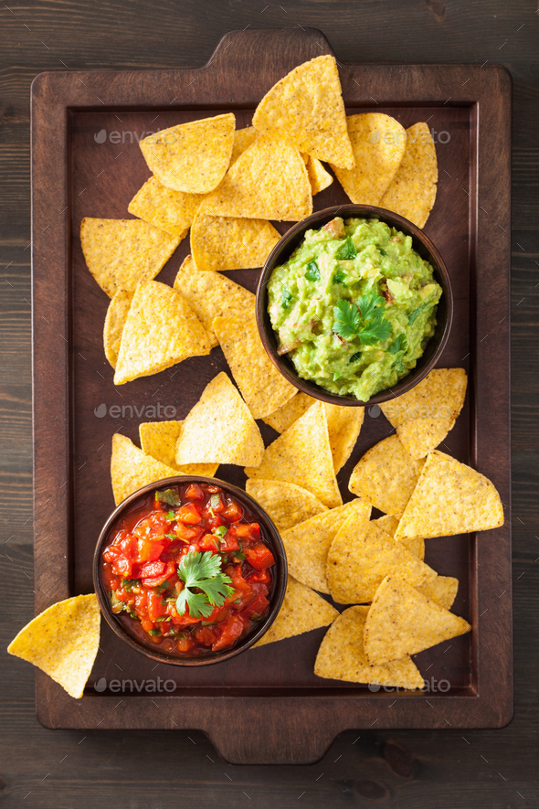 mexican guacamole and salsa dip, nachos tortilla chips - Stock Photo - Images