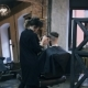 Girl the Hairdresser Shears the Guy with a Clipper. - VideoHive Item for Sale