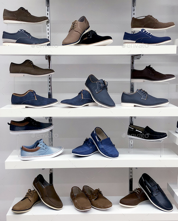 Background with shoes on shelves of shop - Stock Photo - Images