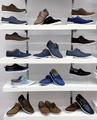 Background with shoes on shelves of shop - PhotoDune Item for Sale