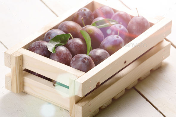 Wooden crate with plums - Stock Photo - Images