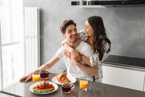 Portait of gorgeous couple smiling, and enjoying time together w - Stock Photo - Images