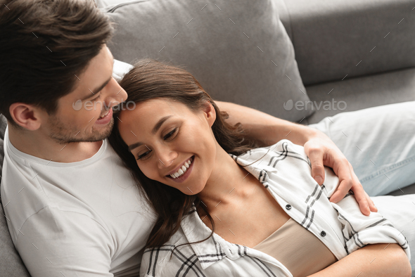 Photo of beautiful couple man and woman smiling, and resting tog - Stock Photo - Images
