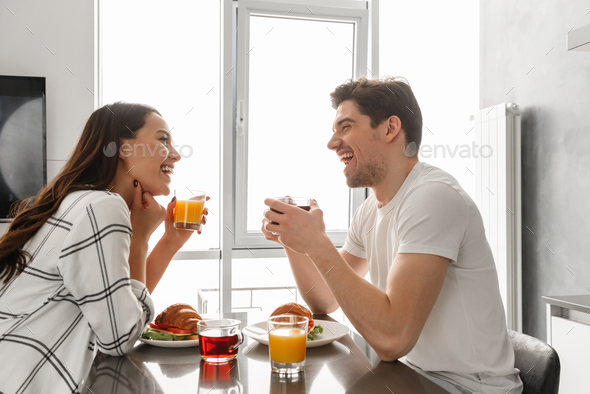 Portait of beautiful happy family man and woman looking at each - Stock Photo - Images