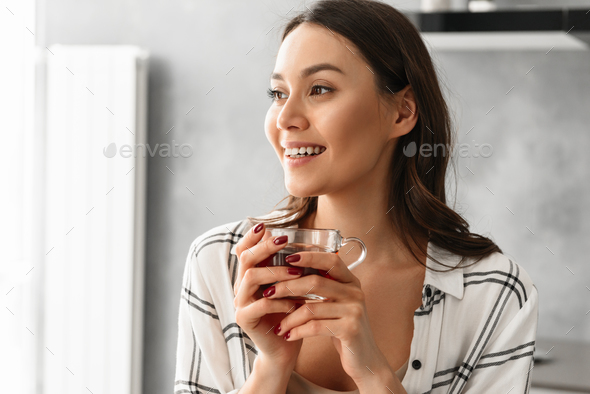 Portrait closeup of pretty woman in casual wear looking aside wi - Stock Photo - Images