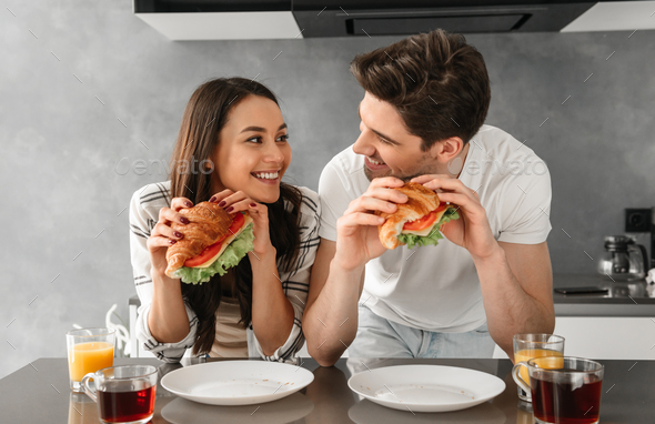 Young and beautiful couple looking at each other and smiling, wh - Stock Photo - Images