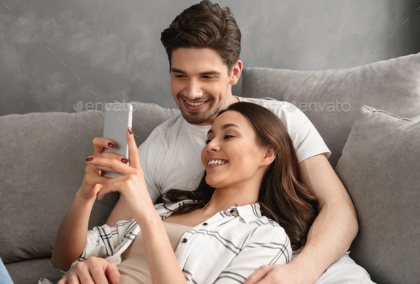 Portrait of happy couple man and woman smiling and resting in li - Stock Photo - Images
