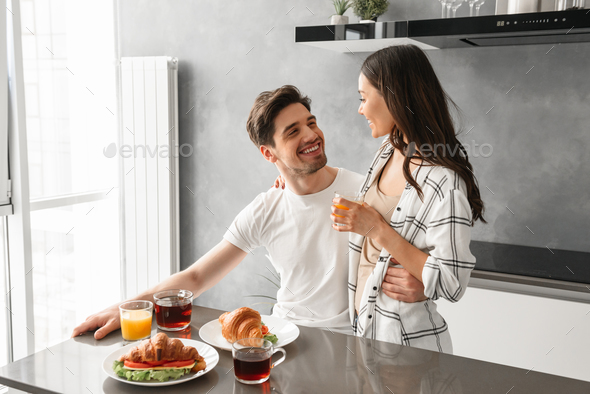 Portait of happy couple smiling, and enjoying time together whil - Stock Photo - Images