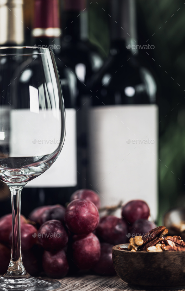 Bottles Of Red Wine, Wine Glass And Grapes - Stock Photo - Images