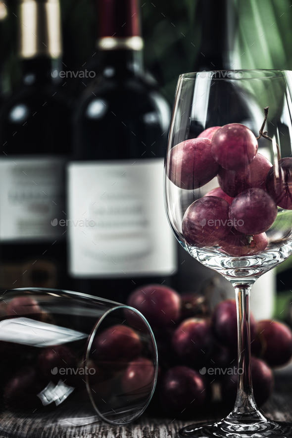 Bottles Of Red Wine, Wine Glasses And Grapes - Stock Photo - Images