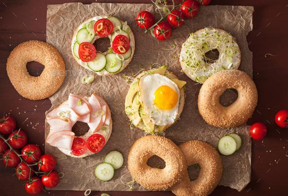 variety of sandwiches on bagels: egg, avocado, ham, tomato, soft - Stock Photo - Images