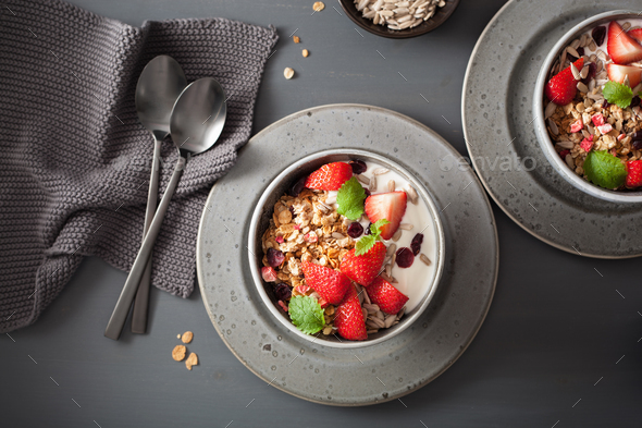 granola and yogurt with seeds and strawberry for breakfast - Stock Photo - Images