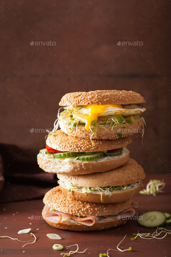 variety of sandwiches on bagels: egg, avocado, ham, tomato, soft - Stock Photo - Images