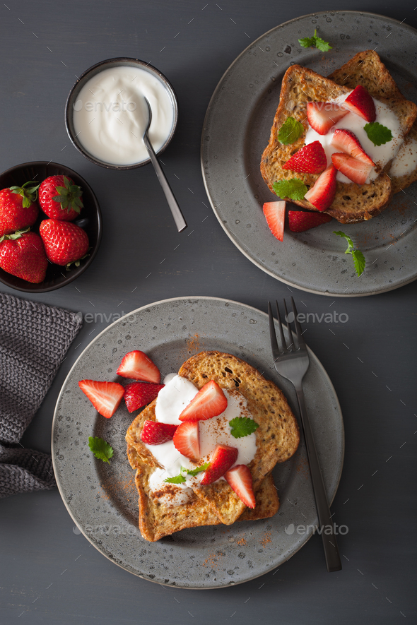 french toasts with yogurt and strawberries for breakfast - Stock Photo - Images