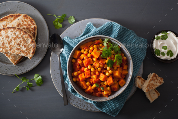 sweet potato and chickpea curry with naan bread - Stock Photo - Images