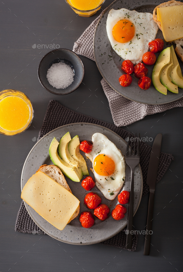 fried egg, avocado, tomato for healthy breakfast - Stock Photo - Images