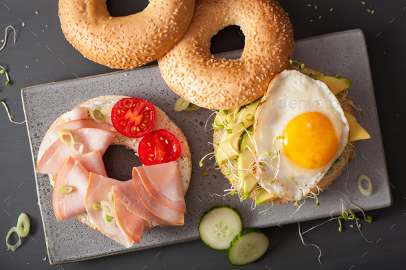 sandwiches on bagels with egg, avocado, soft cheese, alfalfa spr - Stock Photo - Images