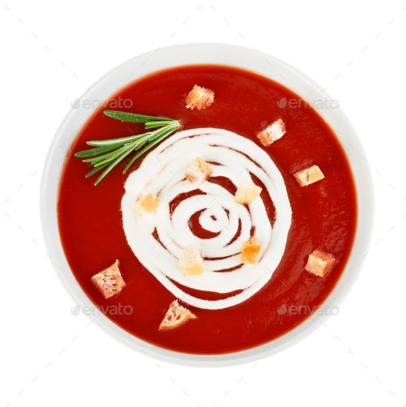 Bowl of tomato soup with croutons close-up isolated on a white background. - Stock Photo - Images