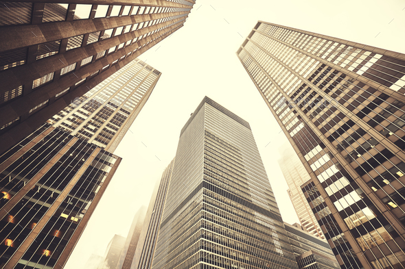 Looking up at Manhattan skyscrapers on a foggy day. - Stock Photo - Images