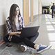 Student Girl in a College sitting with Laptop - VideoHive Item for Sale
