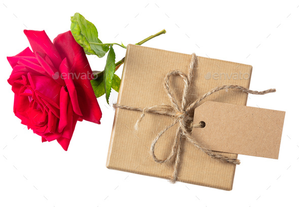 Rose red flower and a gift box with a blank tag on a white background, top view, space for text - Stock Photo - Images