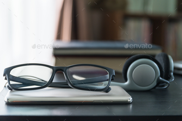 Headphones with book and mobile phone_-8 - Stock Photo - Images