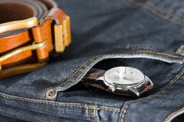 Wrist watch and leather belt on jeans-5 - Stock Photo - Images