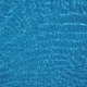 Pure Blue Water in the Swimming Pool with Light Reflections. Aerial Footage - VideoHive Item for Sale