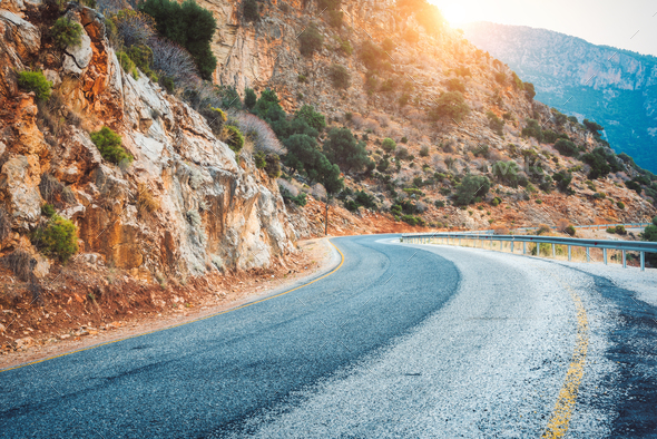 Mountain road at sunset in Europe. Landscape - Stock Photo - Images