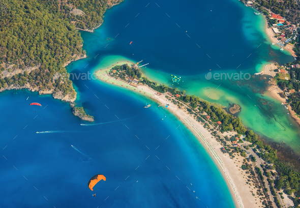 Colorful summer landscape with sea spit, green forest, azure water - Stock Photo - Images
