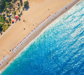 Aerial view of sandy beach with colorful chaise-lounges and blue sea - PhotoDune Item for Sale