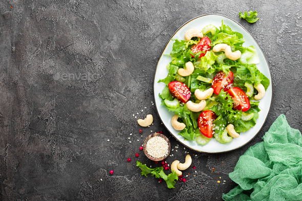 Salad with fresh vegetables and nuts - Stock Photo - Images
