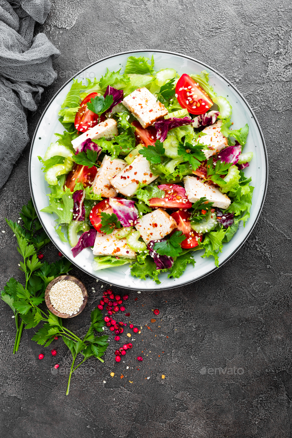 Meat salad with fresh vegetables. Vegetable salad with baked chicken breast - Stock Photo - Images