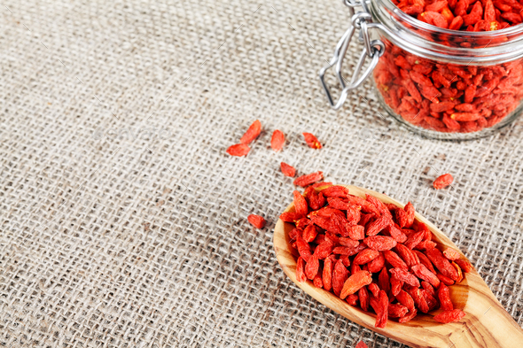 Dried goji berries on a wooden spoon. - Stock Photo - Images
