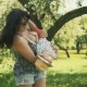 Young Mother with Her Adorable Two Year Old Boy Playing Outdoors with Love