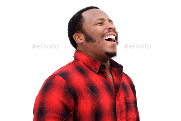 Close up portrait of young african american man laughing - Stock Photo - Images