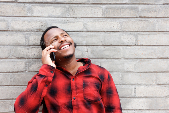 happy african american man talking on cellphone - Stock Photo - Images