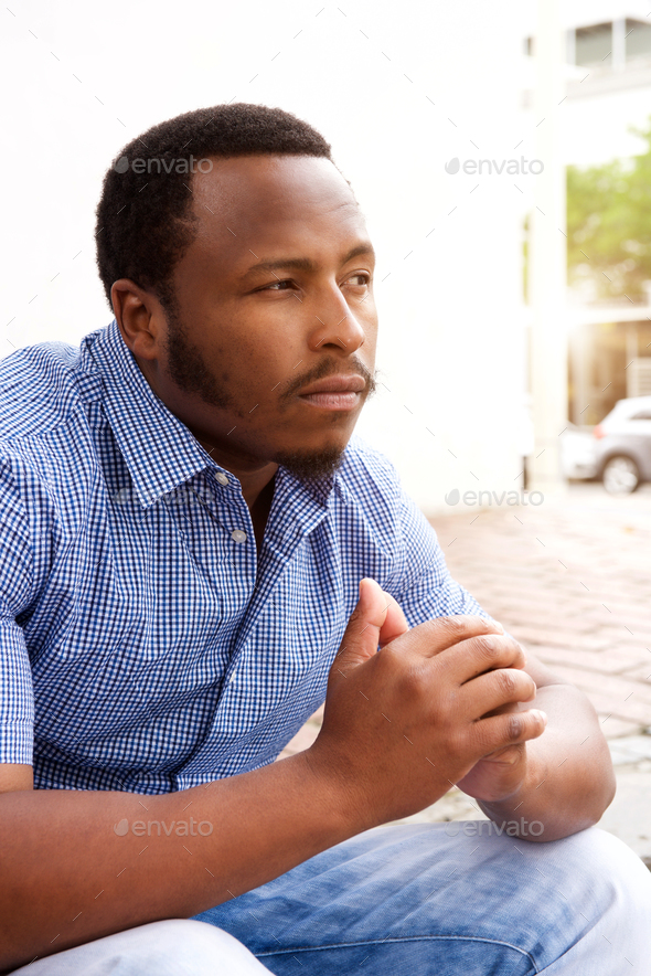 young african man in contemplation - Stock Photo - Images