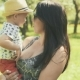 Young Mother with Her Adorable Two Year Old Boy Playing Outdoors with Love - VideoHive Item for Sale