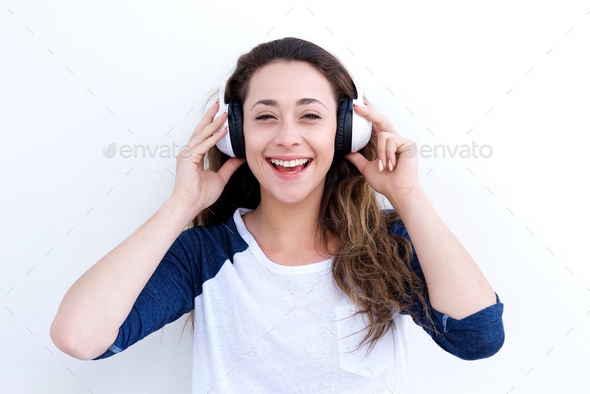happy young woman laughing and listening to music with headphones - Stock Photo - Images