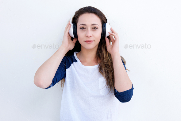 beautiful young woman listening to music with headphones - Stock Photo - Images