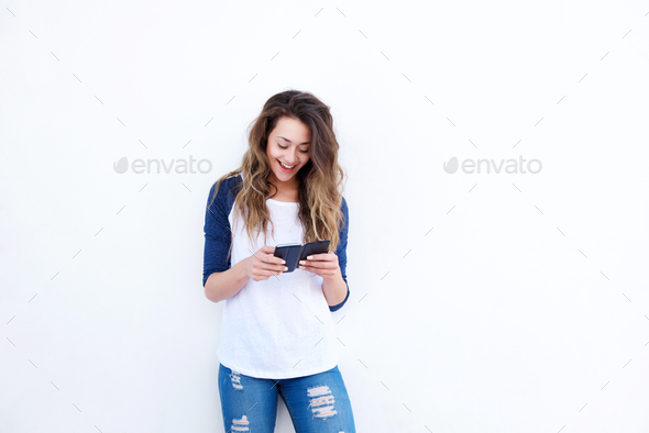 happy young woman using smart phone - Stock Photo - Images