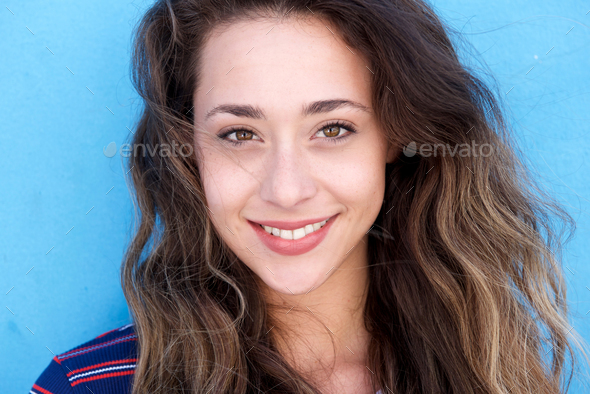 Close up young beautiful woman smiling - Stock Photo - Images
