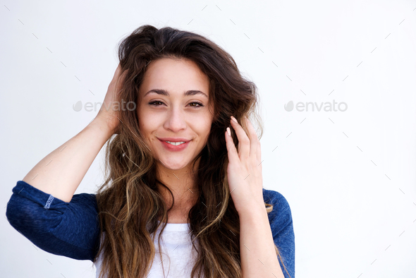 young beautiful woman with hands in hair - Stock Photo - Images