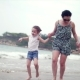 Young Family, Mother and Children Are Walking Along the Coast. Happy Family Walking on Sea Coast. - VideoHive Item for Sale