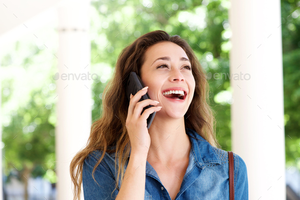 Close up young woman outside talking on cellphone - Stock Photo - Images