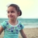 Little Girl on the Beach, Happy Little Baby Playing with Sand on the Beach. A Child, a Child - VideoHive Item for Sale