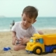 Two-year Old Beautiful Baby Toddler Boy Riding a Toy Cargo Car on Summer Beach . - VideoHive Item for Sale